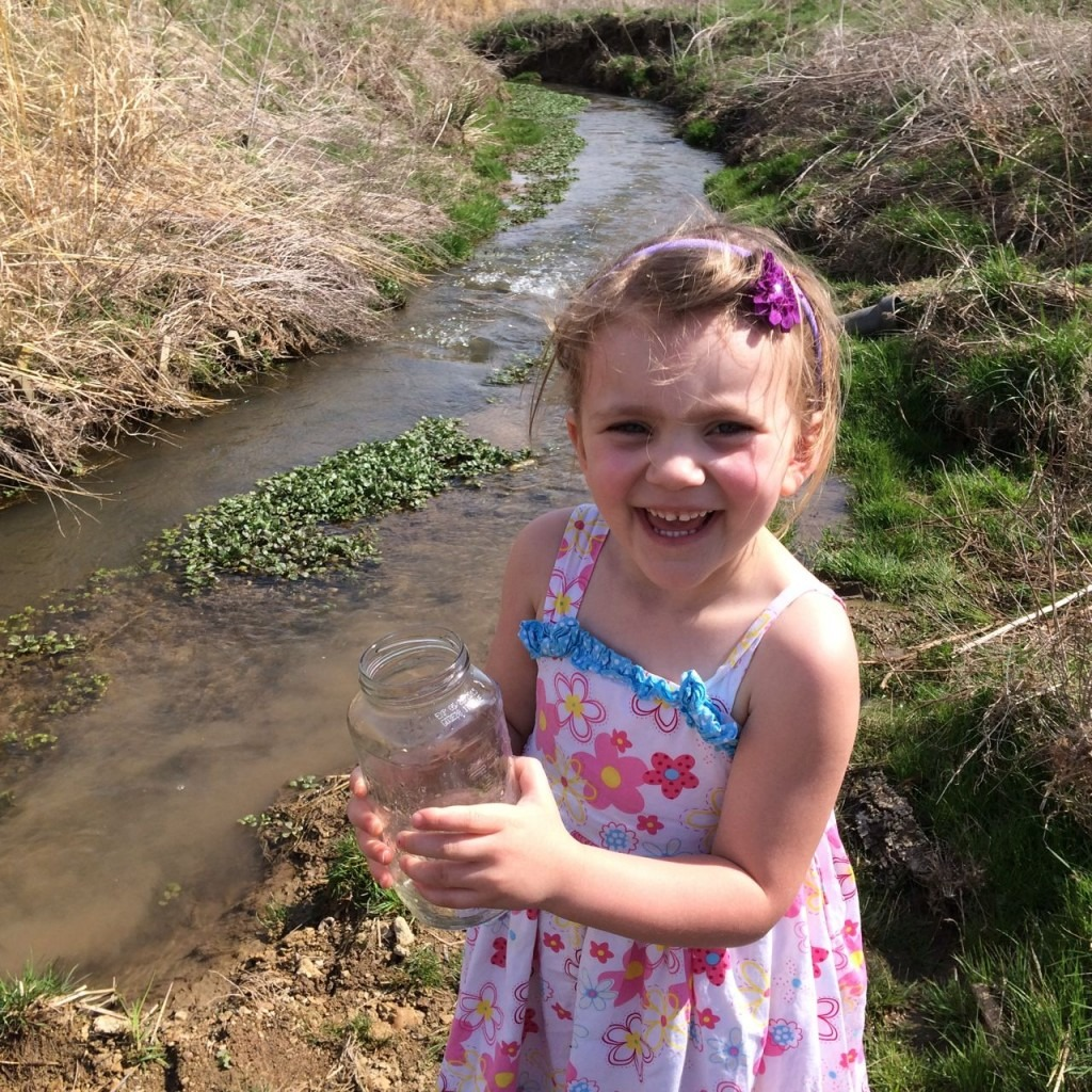 Emma eagerly carries her Brook Trout to the waters edge to release. Poague Run watershed has been restored