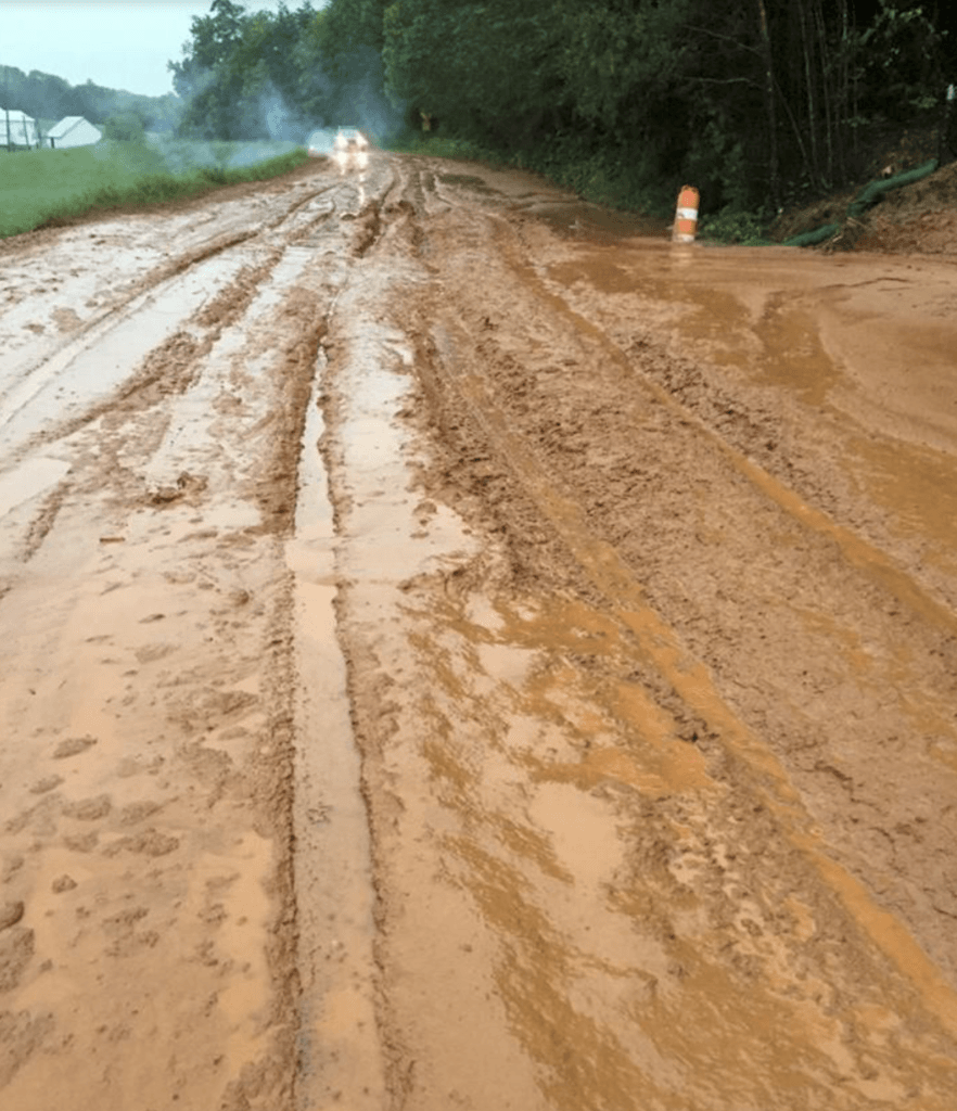 Cahas Mountain Road closed because of sediment.